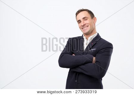 Heerful Guy Laughing And Looking At Camera With A Big Grin.