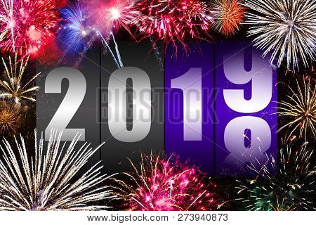 Counter changing year 2018 to 2019 with fireworks display. Happy new year concept.