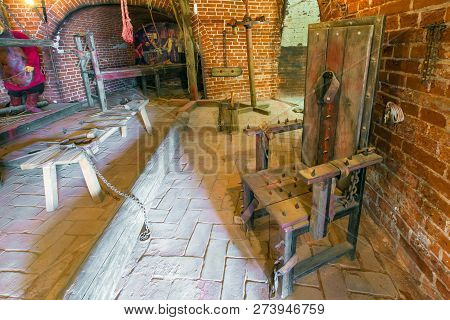 Exposure Excruciation Tools From The Inside In The Museum Room With Red Brick Walls. Torture Room, A
