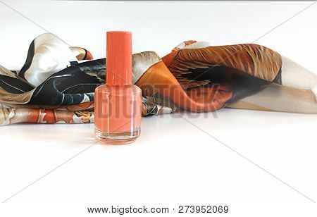 Coral Color As Trend Of The Actual Colors For Season. Isolated Nail Bottle And Silk Neckerchief On W