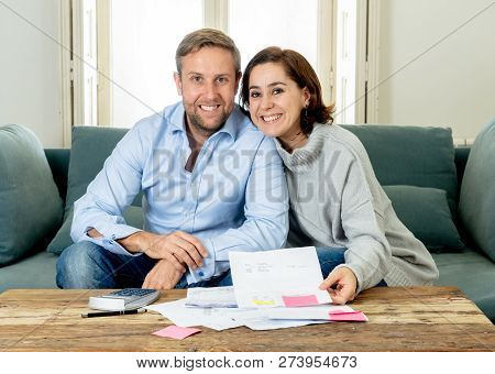 Happy Young Couple Feeling Proud Of Home Finance