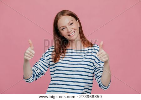 Happy Young Pretty European Lady Give Double Thumb Up, Likes Somebody Idea Or Gives Approval, Dresse
