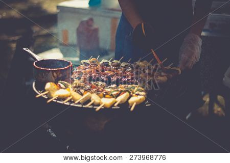 Preparation Of Barbecue, Grilled Skewers On Plate Outdoor. Grilled Shish Kebab On Metal Skewer. Chef