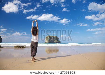 Happy Barefoot Woman In Ballota Beach