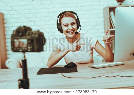 Blogger Makes A Video. Blogger Is Gamer Is Smiling Woman. Camera Shoots A Video. Woman In Headphones