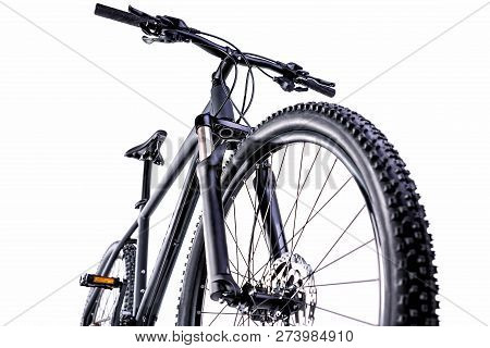 Black Mountain Bike Against A White Background