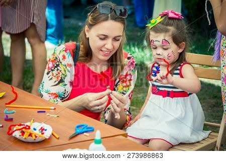 Zaporozhia/ukraine- June 2, 2018: Charity Family Festival -  Mother And Daughter - Small Girl With F
