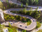 Aerial view of curvy forest road, Road traffic in Bicazului Gorges, Romania poster