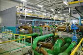 Pipes, filters and sewage pumps inside modern industrial wastewater treatment plant. poster