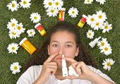 Teenage girl using nose spray for her pollen and grass allergies (Allergy relief) poster