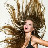 Perfect long hair. Blonde wave long hair. Perfect girl smiling on white background. Beauty and perfect health hair. Beauty model with perfect clean skin. Long hair poster