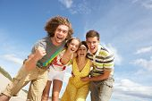 Group Of Friends Having Fun On Summer Beach poster