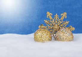 Christmas Golden Decor Balls And Snowflake In Snow