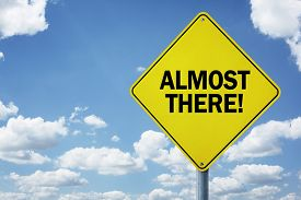 Almost there road sign concept for business motivation, encouragement and approaching a destination or goal