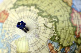 Miniature Figurine Of Man Standing On Earth Globe