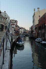 Back Alley Waterway In Venice Italy. Vertical Shot.
