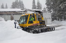 Heavy Snow. Snowstorm. Snow Removal Vehicle Removing Snow.