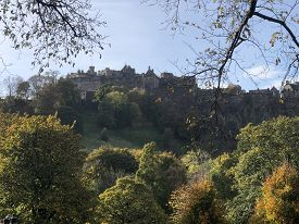 View Of Edinburgh Castle From Princes Street (edinburgh, Scotland, Uk) With Trees And Branches In Fo