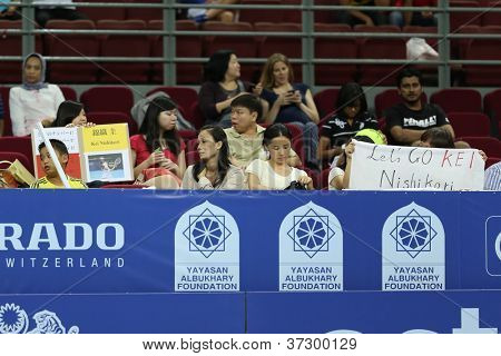 KUALA LUMPUR - SEP 27: Fans of Kei Nishikori of Japan cheer him on in his round 2 match at the ATP Tour Malaysian Open 2012 on September 27, 2012 at the Putra Stadium, Kuala Lumpur, Malaysia.