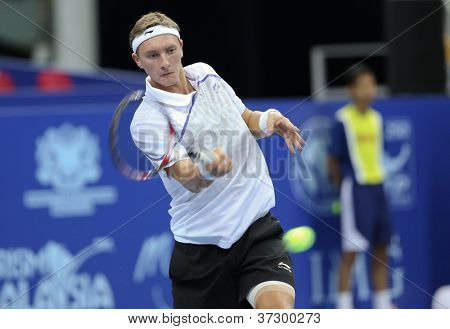 KUALA LUMPUR - SEP 27: Denis Istomin (Uzb) plays his round 2 match at the ATP Tour Malaysian Open 2012 on September 27, 2012 at the Putra Stadium, Kuala Lumpur, Malaysia. He lost to Nikolay Davydenko.
