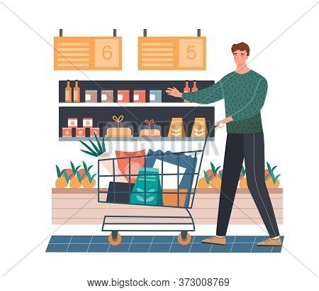 Man Doing The Grocery Shopping In A Supermarket Selecting Goods Off The Shelf To Put In His Trolley,