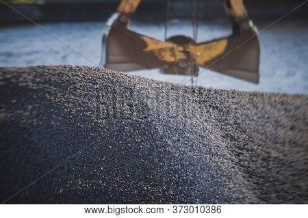 Bulk-handling Crane Unloading Sand, Road Metal And Gravel From Cargo Vessel Ship, Heavy Vehicle And