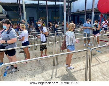 Orlando, Fl/usa - 6/13/20:  People In Line For The Spiderman Ride At Universal Studios During The Re