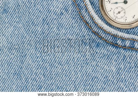 Retro Pocket Watch With Blue Jeans Denim Material With Stiches With Copy Space