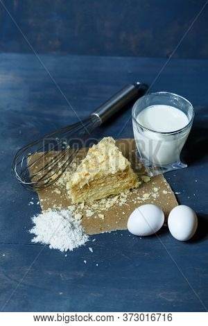 Homemade Napoleon Cake With Cream On A Gray Background