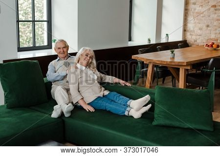 Elderly Couple Doing Massage And Chilling On Sofa During Quarantine