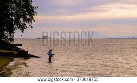 Sunrise Over Sea And View From Labuan Island,malaysia With Fisherman And The Majestic Mount Kinabalu