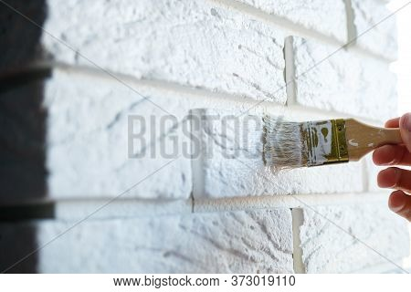 Painting Plaster Decorative Brick With White Paint