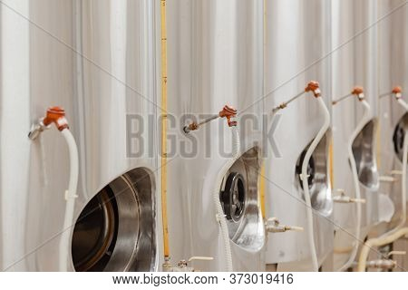 Vertical Camp Tanks, Cylinder-conical Fermentation Tanks. Beer Production. Beer Tank