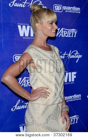 LOS ANGELES - SEP 21:  Jaime Pressly arrives at the Variety and Women in Film Pre-Emmy Event at Scarpetta on September 21, 2012 in Beverly Hills, CA