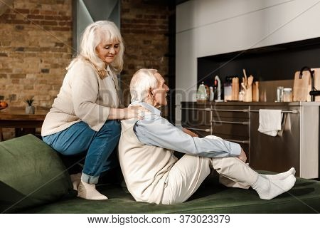 Elderly Couple Doing Massage And Chilling At Home On Quarantine