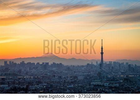 Beautiful Tokyo Sunset Cityscape ,  Tokyo Sky  Tree Landmark And Mountian Fuji In Winter Sunset
