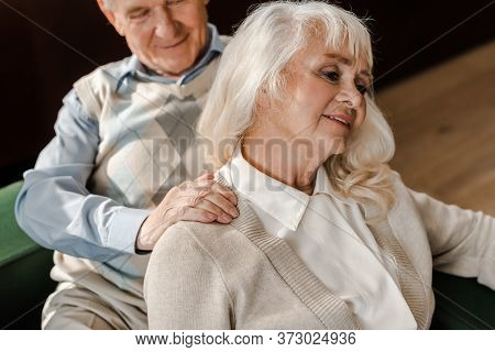 Elderly Couple Doing Massage And Chilling At Home On Self Isolation