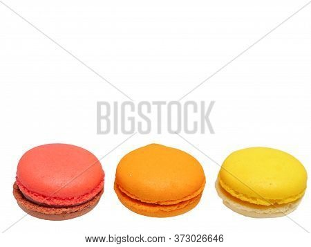 Raspberry, Orange, And Lemon Flavoured Macaroons With Chocolate And Jam Filling, Macro Top View Clea