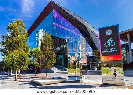 Sydney, Australia - February 25, 2020: Pedestrian Area At The Darling Harbour And A Slow Down Bikes