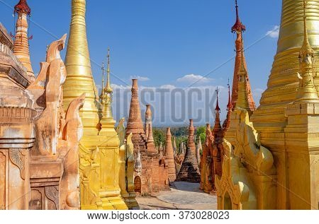 The Golden Buddhist Stupas Of Shwe Inn Thein Paya  Is A Complex Of 1054 Stupas In The Village Of Ind