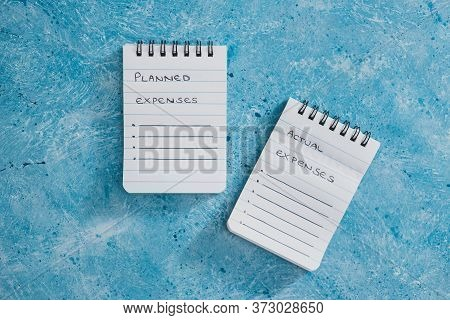 Managing Money And Finance Concept, Planned Expenses Vs Actual Expenses Notepads Side By Side On Blu
