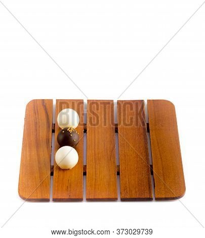 Three Chocolate Candies On A Wooden Trey, Top View, Isolated On White Background, Round Chocolate Ba