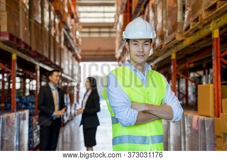 Warehouse Workers In Warehouse With Managers,warehouse Worker Smiling At Camera In A Large Warehouse