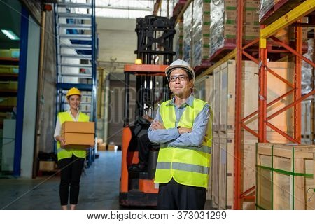 Team Warehouse Workers In Warehouse With Managers Working At The Large Warehouse,wholesale,logistic,