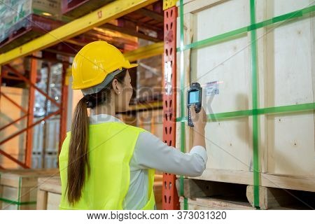 Worker Working Checking And Scanning Package Products By Laser Barcode Scanner In The Large Warehous
