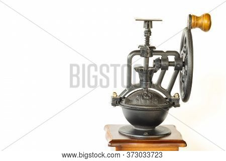 A Vintage Coffee Grinder With Intricate Metal Part, Isolated On White Background