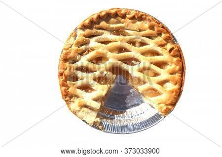 Apple Pie. Fresh Baked Apple Pie. Isolated on white. Lattice top Apple Pie. Home Made Fresh Baked Apple Pie with a section removed. Room for text.