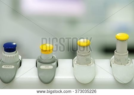 A Set Of Measuring Pipetted On A Rack In The Laboratory, Blurred Background