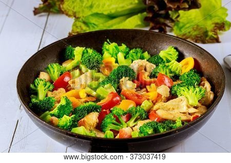 Stir-fry With Chicken, Broccoli And Bell Peppers. Chinese Cuisine.