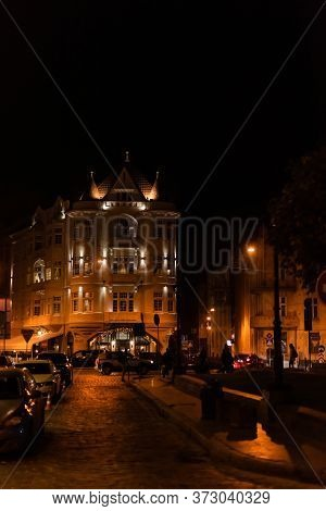 Lviv, Ukraine - October 23, 2019: Atlas Hotel Lettering On Building Near Road With Cars And People